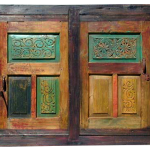 Driveway gate with carved panels