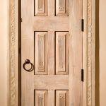 Door in carved surround