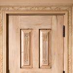 Detail of door in carved surround