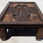 coffee table with antique carved panel