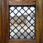 Grilled window in entry gate
