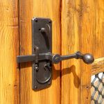 Entry gate hardware with deadbolt