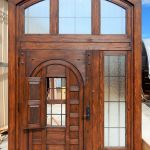 Front door with sidelights, transom and grilled operable shutter