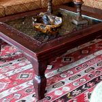 Detail of coffee table with iron grillwork