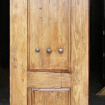 Side of media cabinet made with antique Mexican doors