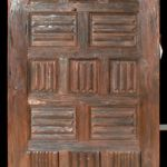 Custom front door made with antique carved door