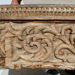 Side detail of carved mantel