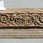 Original antique fragment used to make carved mantel