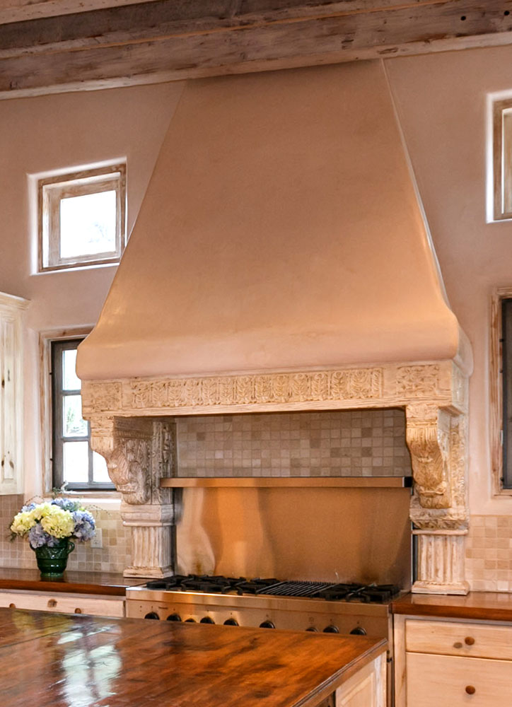 Stove hood with antique corbels