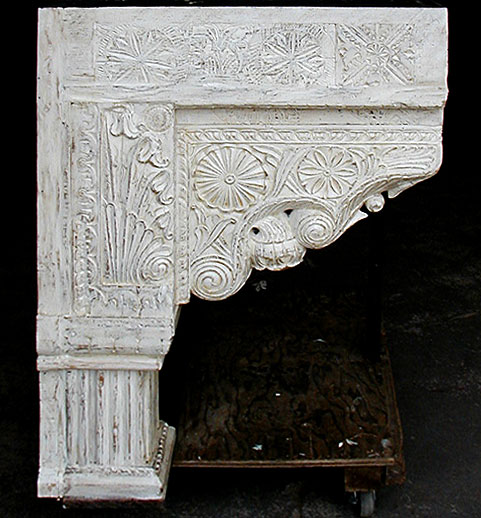 Side of stove hood with carved corbels