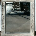Carved mirror 1 of 2