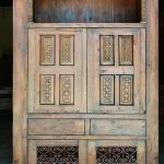 Media cabinet with carved panels