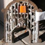 Antique stove grill for front entry peep door
