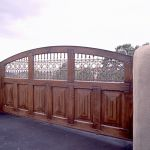 Driveway gate with grillwork
