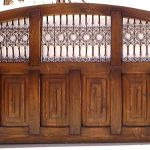 Wooden driveway gate with grillwork