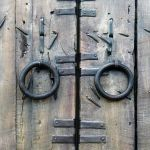 Antique iron strapping details on custom gate