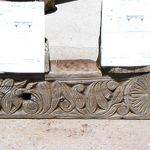 Antique column used to make mantel with carving