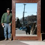 Scale photo of antique wood mirror