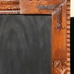 carved mirror with L-strapping detail