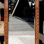 carved mirror with L-strapping