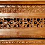Carving cutout work on elaborately carved mirror
