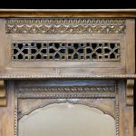 Top detail on one of two elaborately carved mirrors
