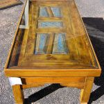 Coffee table with panels and glass