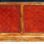 Some panels feature leather panels accented with upholstery tacks