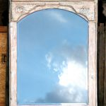 One of six mirrors with carved surrounds