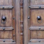 Detail of door carving, clavos and pull rings