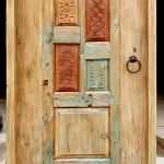 Back of custom entry gate with carved panels