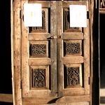 Antique cabinet doors used to make gate
