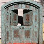 Open top shutters on custom green zaguan gate