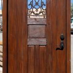 Arched door with grilled peep front
