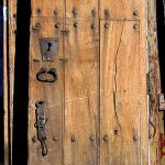 Second of two antique doors used to make a custom double gate