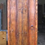 Front of small arched door