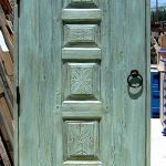Custom arched door with carved antique panels