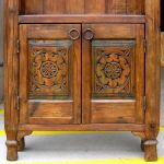 Cabinet doors with antique carved panels