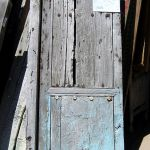 Antique door used to make blue Dutch door