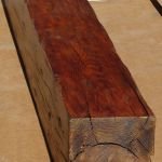 Header beam made from salvaged heavy timbers
