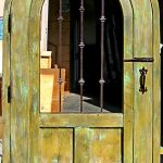 Back of arched gate with grilled window