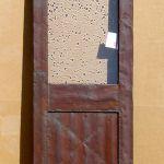 Tin clad bar door with original matte finish