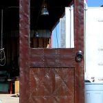 Tin clad bar door with new finish