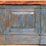Side of blue buffet cabinet