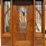 Front entry with sidelights and carved panels