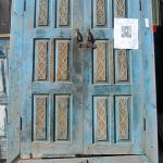 Antique cabinet doors with carved panels