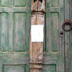 Antique carved column used to make custom newel post