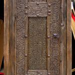 Intricately carved powder room door