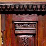 Detail of carved fragment on custom cupboard