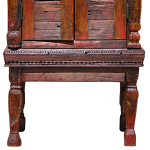 Detail of antique dowry chest legs on cabinet